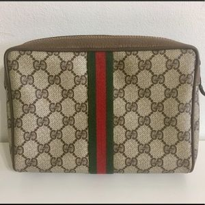 Authentic GUCCI brown coated canvas clutch